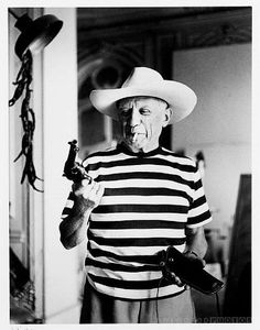 Rene Burri - Picasso with revolver and hat of Gary Cooper, Cannes, 1958 . Selected Photos