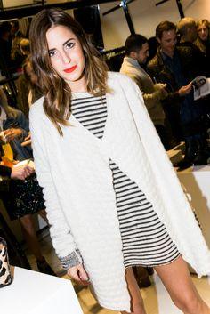 Striped dress, sweater, lip pop.