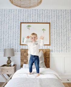 Pretty kids room with blue herringbone wall paper