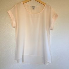 Forever 21 Light Pink/Blush Top Light pink/blush color top.  The back is longer than the front.  The seams on the sides underneath the sleeves show on the exterior instead of the interior, however it doesn't take away from the look of the top.  Used and in excellent condition.  Size M.  No trades. Forever 21 Tops Blouses