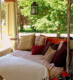 Custom made Front porch swing bed using an old futon cushion & old pillows. Coverlet made with old curtains. Description: Check out Lowe's Idea Exchange today to see more inspiring projects.