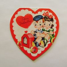 Vintage Valentine card A-meri-card folded heart shaped little boy and girl riding in peddle car