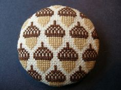 Cross stitch brooch- Acorns by Betty Breeze, via Flickr