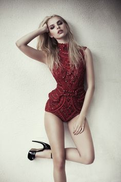 Dioni sizzles in red bodysuit sexy.. Love it...