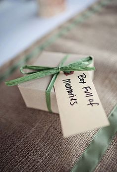Boxed wedding favors with green ribbons and DIY tags (Cuppa Photography)