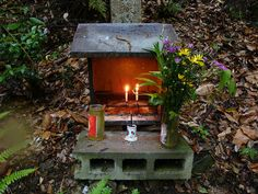 We found this altar as we climbed a hill behind the Zen Buddhist temple, Nanzen-ji, in Kyoto, Japan, on a rainy Saturday in May. A guy ahead of us lit the candles of every altar along the path. Pagan Altar, Wiccan, Witchcraft, Personal Altar, Home Altar, Meditation Space, Book Of Shadows, Kawaii, Garden Art