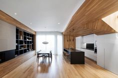 MXMA Architecture & Design Create a Contemporary Home with Elegant Wooden Surfaces in Montreal