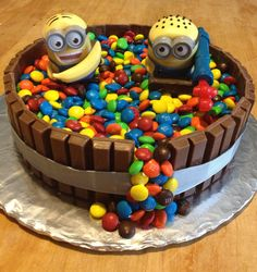 Minions cake with over flowing M&M's out of Kit Kat tub! Candy cake!