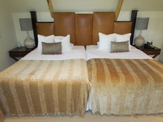 The master bedroom of The Khoi Khoi Suite with ostrich leather headboards