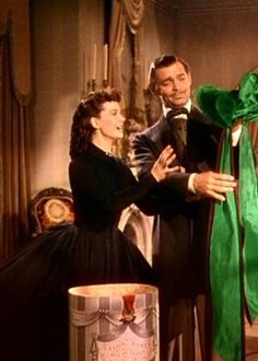 Gone with the Wind. Love this scene and how she puts the hat on backwards and he looks at her with the sweetest face. :)