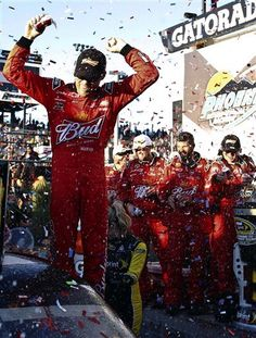 Kevin Harvick celebrates with his pit crew in victory lane after his win at the NASCAR Sprint Cup Series auto race at Phoenix International Raceway, Sunday, Nov. 11, 2012, in Avondale, Ariz.