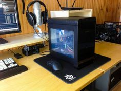 Building a small form factor micro ATX or mini ITX machine is well worth it. The reward for building such a machine is versatility to move your gaming machine just about wherever you'd like to.