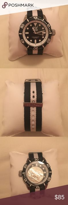 NWOT Men's Nautica Watch This is a brand new (without tags) men's nautica Watch - black and white. Quarter placed on Watch face for reference. Nautica Accessories Watches