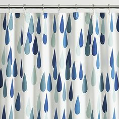 "Oversized raindrops (""pisaroi"" in Finnish) rain beautiful shades of green and blue on white in Maija Louekari's delightful design that's casual, clean and timeless."