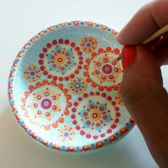 Dot painting on pottery.  So pretty.