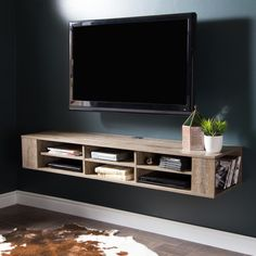 Play the same trick with a floating media center to create the illusion of more floor space and a little extra storage space underneath during desperate times.