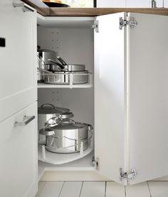 Corner base cabinet with open door revealing carousel