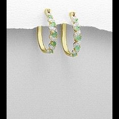 "Gold,  Emerald and White Diamonds. 14k gold and rhodium over brass hoop earrings decorated with emerald and white diamond. Width 4 mm  Height  1"" Jewelry Earrings"