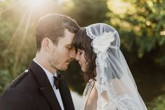 Bride Imogen wore the 'Jayne' gown by Eliza Jane Howell, and a Juliet cap veil, for her Celtic handfasting wedding at a French cheateau. Photography by Lifestories Wedding Photography.