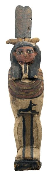 Wooden Ptah Sokar Osiris in mummy form, wearing a crown and a chin beard, with painted designs and a seated jackal on the front. Ptolemaic, 305-30 BC