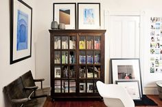 Jesse's Modern Bachelor Pad. Color-coded books behind glass cabinet.