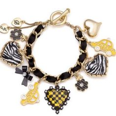 Betsey Johnson bracelet Selling to buy Betsey pieces I need. This is from the taxi collection. The bracelet is gold with black ribbon entwined. The charms include puffy lucite zebra hearts, flowers, 2 taxi cabs, plaid lucite heart, bow and a puffy heart. New Betsey Johnson Jewelry Bracelets