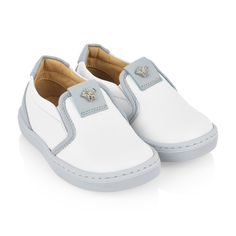 ee36f42af44f Young Versace baby girls white slip on shoes feature embossed Medusa motif  upon the tongue