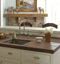 Though it& uncommon to see wood countertops -- besides butcher block -- run throughout a kitchen, a wood-topped island or baking center is popular. Using wood countertops for these prep stations adds instant warmth and charm to a kitchen. Kitchen Redo, Kitchen And Bath, New Kitchen, Kitchen Dining, Kitchen Interior, Kitchen Ideas, Design Kitchen, Kitchen Furniture, Kitchen Countertop Materials