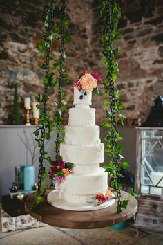 Suspended wedding cake. Lace applique wedding cake with handmade sugar flowers on our custom cake swing made for Orange Tree House, Greyabbey by Candytuft Cakes
