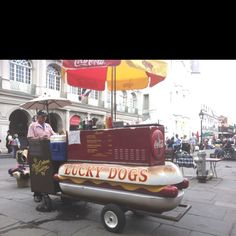 Lucky dogs anyone.....?!!!  Jackson Square.  Looks like Jack McCormick working the the cart.  Notice a little bit of Terri's flower cart in the back ground.