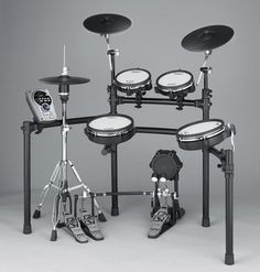 """Roland TD-15KV V-Tour Series V-Drum Set with MDS-9V Stand by Roland. $2999.00. The TD-15KV V-Tour Series V-Drum Set with MDS-9V Stand by Roland is an affordable, middle range drum kit ideal for drummers of all skill levels. It expands on the TD-15K by offering an upgraded kit configuration including two 10"""" PDX-100 series pads with dual-triggering technology and the VH-11 V-Hi-Hat. It also includes two, PD-85BK 8"""" dual-zone V-Pads for toms 1 and 2 which sport a co..."""