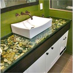 not crazy about the color, but I love the idea for the bathroom sink - would prefer more blues/grays for the rocks