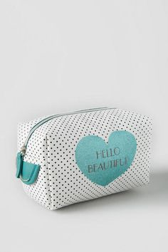 """Decorated with a turquoise heart and the words""""Hello Beautiful"""", this pouchis a fun way to carry your cosmetics and small essentials!<br />  <br />  - 4"""" x 8""""<br />  - Zip closure<br />  - Fully lined<br />  - Imported"""