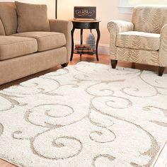 Add a striking accent to the room with this casual power-loomed area shag rug. The cream and beige rug offers a luxurious feel while providing durability. The high-low pile provides a unique design that will lend elegance to any room's setting.
