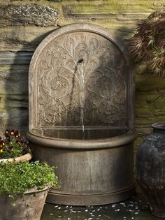 The elegant Corsini Wall fountain is timeless for any garden. Architectural Landscape Design