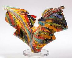 "Varda Avnisan's Explorations in color #1 Art glass sculpture. Made by combining strong colors of oranges, reds and yellows to create a color statement. Unique design for home or office and great conversation piece. Approximately 12.5""h x16""w x12""d."