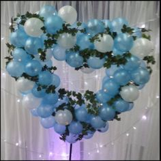 Balloon Heart Sculpture in light blue and white with additional lighting and ivy detail