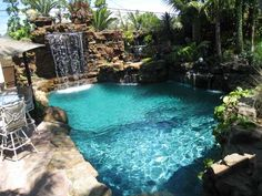 80 Fabulous Swimming Pools With Waterfalls Pictures Flower Arrangements Backyard And Pool