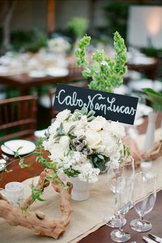Tables named after memorable places in the couple's history.  Great idea!
