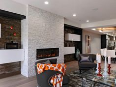 Living Room With White Brick Fireplace Everything about the focal wall in this living room is an attention-grabber, from the white brick fireplace to the floating white shelves. A pair of Winmark barrel chairs provide a cozy fireside spot to socialize with family and friends or relax with a good book.