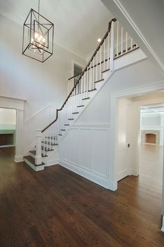Fabulous foyer features staircase wall adorned with board an batten and fitted with an under the ...