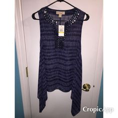 NWT Michael Kors dark blue flowy tank Gorgeous Michael Kors flowy tank. Dark blue sheer material. Never worn, still has tags. So cute! Size M. MICHAEL Michael Kors Tops Tank Tops
