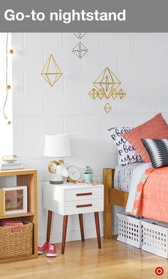 You might be far from home, but this two-tone white and wood accent table doubles as a nightstand to keep all your prized possessions within reach. Place a small lamp, an alarm clock, and a photo of your best friends on top of it, then fill the two drawers with your bedtime necessities. You'll create a warm, comfortable, and happy place to wake up every day. Just watch out for the snooze button.