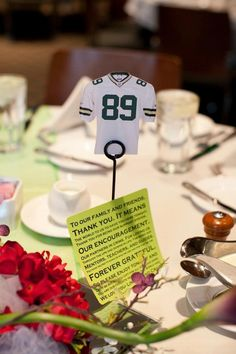 Used football jerseys as table numbers (our wedding reception was at Lambeau field)