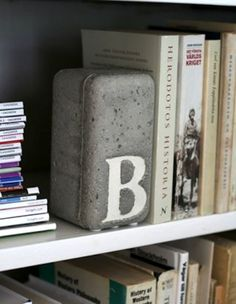 21 Ways to Create Your Own Bookends. Love the brick!