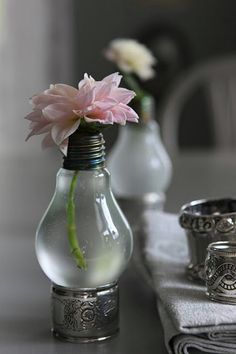 These little light bulb vases are as adorable as they are easy to make. You just have to cut off the bottom of an old light bulb and completely empty out the contents. Rinse it well and be careful to remove all metal fillings from inside it. Then just add water and flowers and use something to hold the vase up. Napkin rings work well or you can completely use your imagination for the base. Tumblr