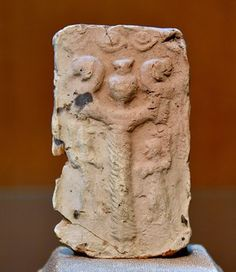 Nergal's mace as imagined on this this Old-Babylonian clay plaque from Nippur (The Sulaymaniyah Museum).