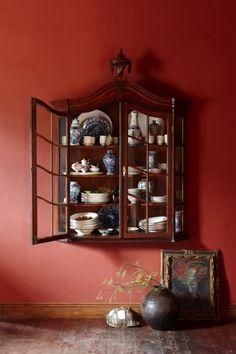 A display case filled with precious ceramics.
