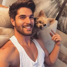 cute guy with a tiny dog on his shoulder
