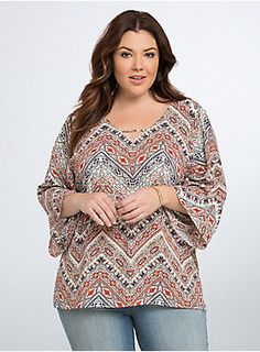 """<p>This free-flowing top radiates good vibes. A boho-babe friendly multi-color, multi-print pattern keeps up the free spirit energy, while crisscrossing straps along the v-neck and back keep the look feeling uniquely modern.</p>  <p></p>  <p><b>Model is 5'9"""", size 1</b></p>  <ul> <li>Size 1 measures 29 1/2"""" from shoulder</li> <li>Polyester</li> <li>Wash cold, dry low</li> <li>Made in USA plus size top</li> </ul>"""